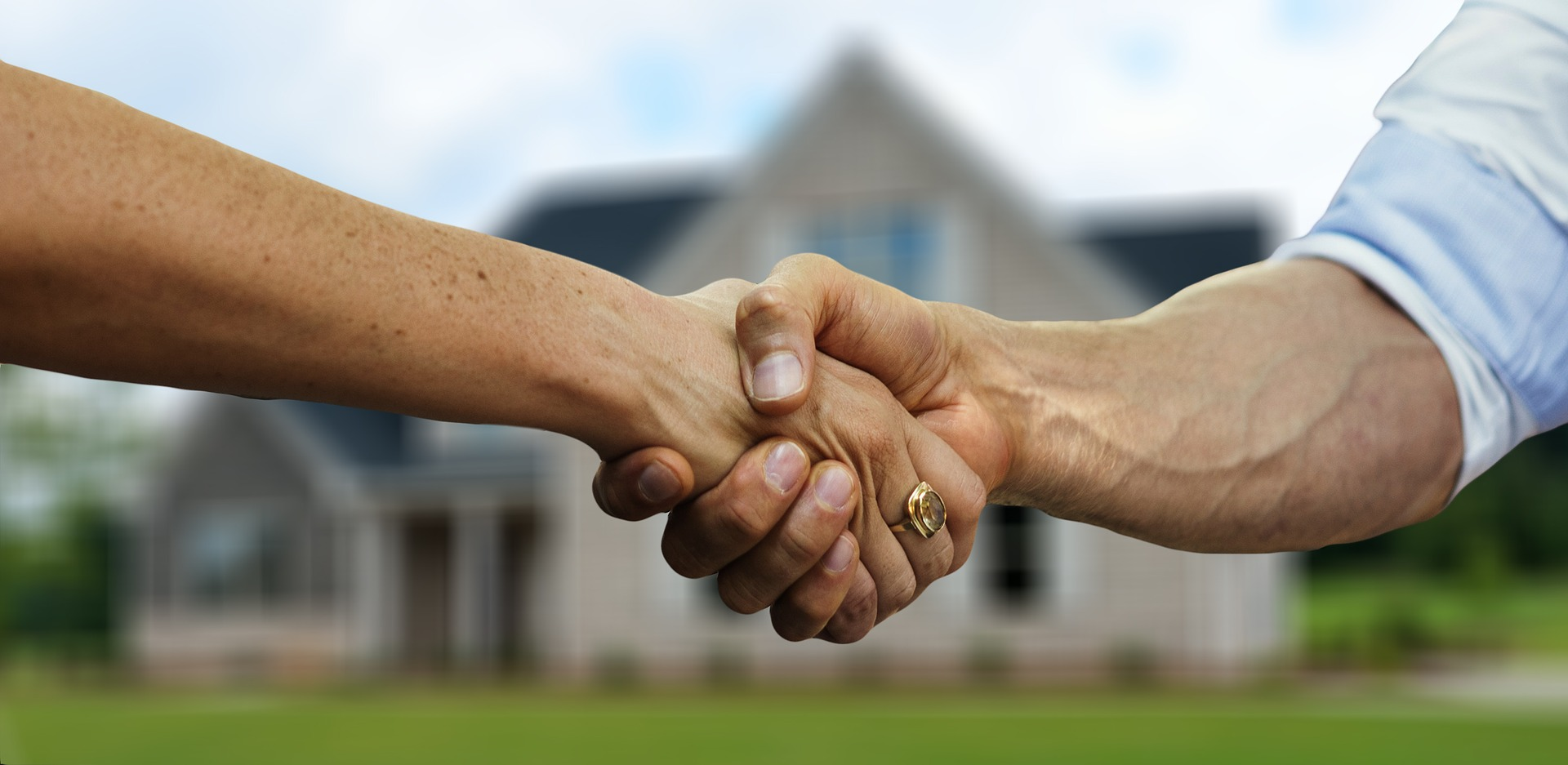 How to win a bidding war | Handshake in front of home