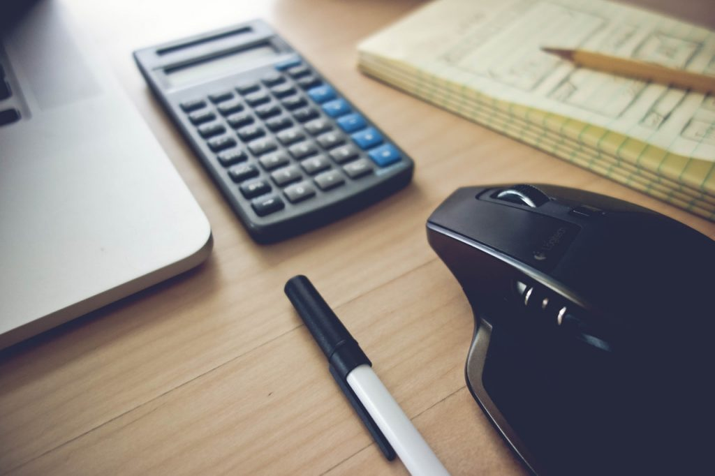 how to work out terms with your lender | calculator and computer mouse